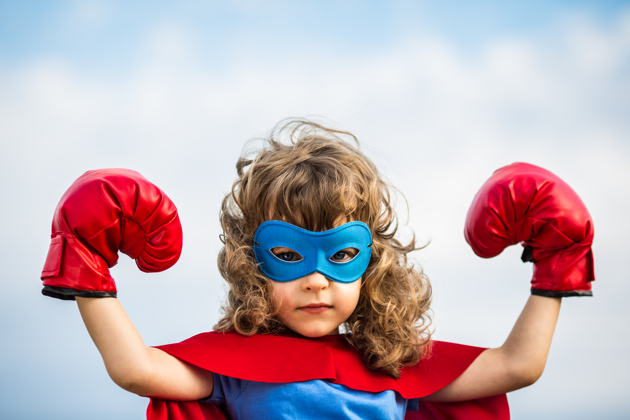http://www.dreamstime.com/royalty-free-stock-photos-superhero-kid-girl-power-concept-wearing-boxing-gloves-against-blue-sky-background-feminism-image33949968